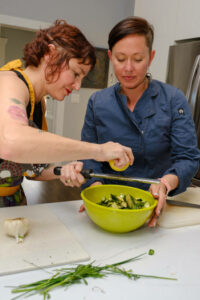 Sarah Daulton creating a salad for Denver Cooking Classes