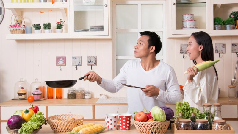 Couple having fun cooking together