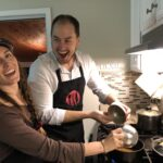 woman and man cooking during couple cooking class