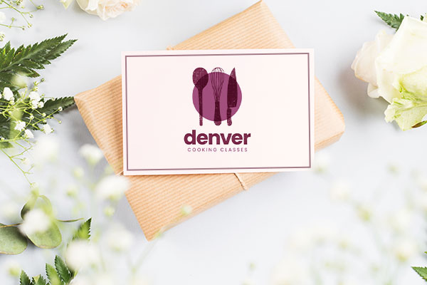 Gift Card for Denver Cooking Classes culinary school pictured on top of wrapped gift