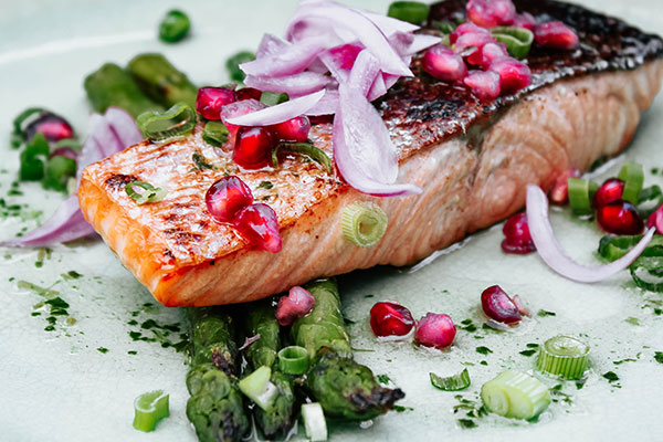 Grilled Salmon over asparagus with cranberries