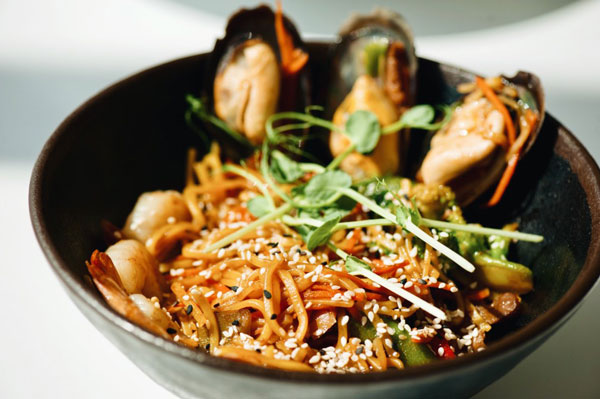 Chinese Noodles in a dish with spices for chinese cooking class